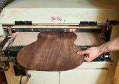Grinding The Back Of The Classical Guitar. Production Of Classical Guitar. poster