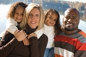 stock photo of mixed race  - A mixed race family enjoying the outdoors - JPG