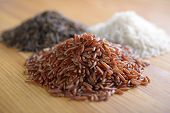 Three variety of rice: red rice, wild rice, and white rice. Shallow DOF