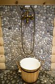 stock photo of bib tap  - Beautiful bronze shower in a warm bath - JPG