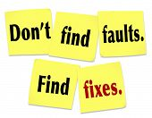 The saying Don't find faults, find fixes with words on yellow sticky notes offering advice on how to