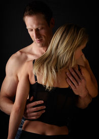 pic of breast-stroke  - Young and fit caucasian adult couple in an embrace - JPG