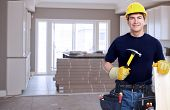 Handyman with a tool belt. House renovation service.