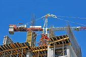 foto of formwork  - Concrete formwork and crane on construction site - JPG