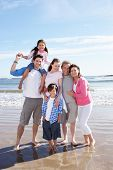 foto of 70-year-old  - Multi Generation Family Having Fun On Beach Holiday - JPG