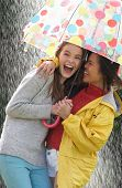 image of 15 year old  - Two Teenage Girl Sheltering From Rain Beneath Umbrella - JPG