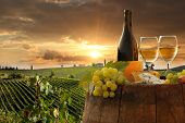 stock photo of food plant  - White wine with barrel on vineyard in Chianti - JPG