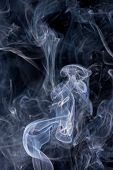 image of hazy  - Smoke or Steam Rising against a Black Background - JPG