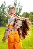 foto of mother baby nature  - Beautiful Mom and baby outdoors - JPG