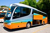 stock photo of motor coach  - Side view of a big modern tour bus parked for the picking up passengers - JPG