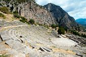 foto of oracle  - The ruins of ancient theater in the archaeological site of Delphi in Greece - JPG