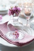 foto of wedding table decor  - Bouquet of pink flowers in a glass bell jar on a festive wedding decorated table a bright summer table decor - JPG
