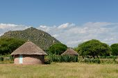stock photo of mud-hut  - Traditional round mud house in africa - JPG