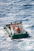 stock photo of work crew  - boatman working on deck supply boat - JPG