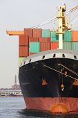 foto of shipyard  - Container Cargo freight ship with working crane bridge in shipyard - JPG