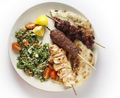 stock photo of tabouleh  - Various barbecued kebabs  - JPG