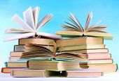 image of short-story  - Stacks of books on table on natural background - JPG
