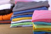 Stack of colorful clothes, on light background