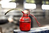 foto of oil can  - red oil can in production hall close up - JPG