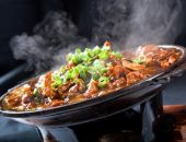 stock photo of chinese food  - Chinese style steaming stew beef over black background - JPG