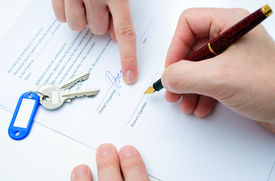 image of rental agreement  - Rental agreement form with signing hand and keys and pen