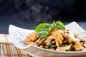 stock photo of stir fry  - Chinese chicken stir fry with mushroom over black background - JPG