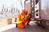 foto of substation  - two electrical engineers discussing work in substation - JPG