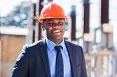 stock photo of substation  - portrait of african industrial businessman in electrical substation - JPG