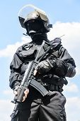 image of anti-terrorism  - Spec ops soldier in black uniform and face mask with his rifle