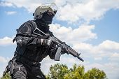 pic of anti-terrorism  - Spec ops soldier in black uniform and face mask with his rifle - JPG