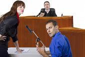 picture of courtroom  - defendant with lawyer speaking to a judge in the courtroom - JPG