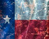 stock photo of texas flag  - Texan flag waving in the wind with some damage - JPG
