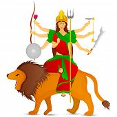 stock photo of sita  - Statue of Goddess Durga sitting on her lion and holding weapons in her each hands - JPG