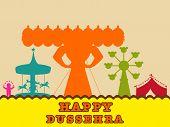 image of ravana  - Statue of Ravana in orange in the fair of dusssehra with swings - JPG
