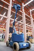 stock photo of cherry-picker  - an orange lift Bucket of cherry picker - JPG