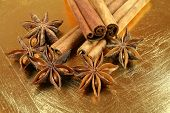 picture of ouzo  - Anise stars and cinnamon sticks on golden cracked plate  - JPG
