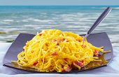 pic of carbonara  - Pasta alla carbonara with sea on the background - JPG