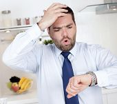pic of running-late  - Businessman running late for work at home - JPG