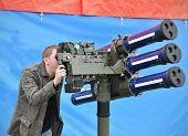 stock photo of artillery  - Man testing heavy artillery gun in army - JPG