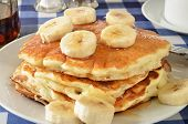 pic of buttermilk  - Banana pancakes on a picnic table with a cup of coffee - JPG