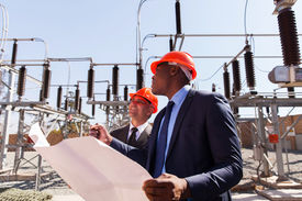 stock photo of substation  - industrial managers working in electric substation - JPG