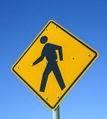 stock photo of pedestrian crossing  - The Pedestrian crossing sign under blue sky - JPG