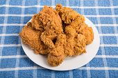 picture of southern fried chicken  - Fresh crunchy fried chicken on a white plate - JPG