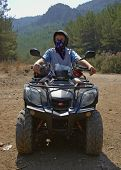 pic of four-wheeler  - Quad biker on dirt road - JPG