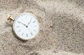 image of wind up clock  - Close up photo of Pocket watch buried in the sand - JPG