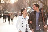 pic of lovers  - Urban couple walking on La Rambla Barcelona arm in arm - JPG