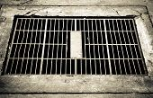 stock photo of rough-water  - Steel cover water drainage - JPG