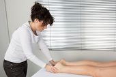 picture of foot massage  - Foot massage. Female hands giving massage to soft bare foot ** Note: Soft Focus at 100%, best at smaller sizes - JPG