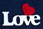 picture of denim jeans  - Wood Love text with red fabric stitched heart on blue denim jean texture background - JPG
