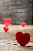 foto of two hearts  - Red Valentine hearts on old rustic wooden background. Valentine